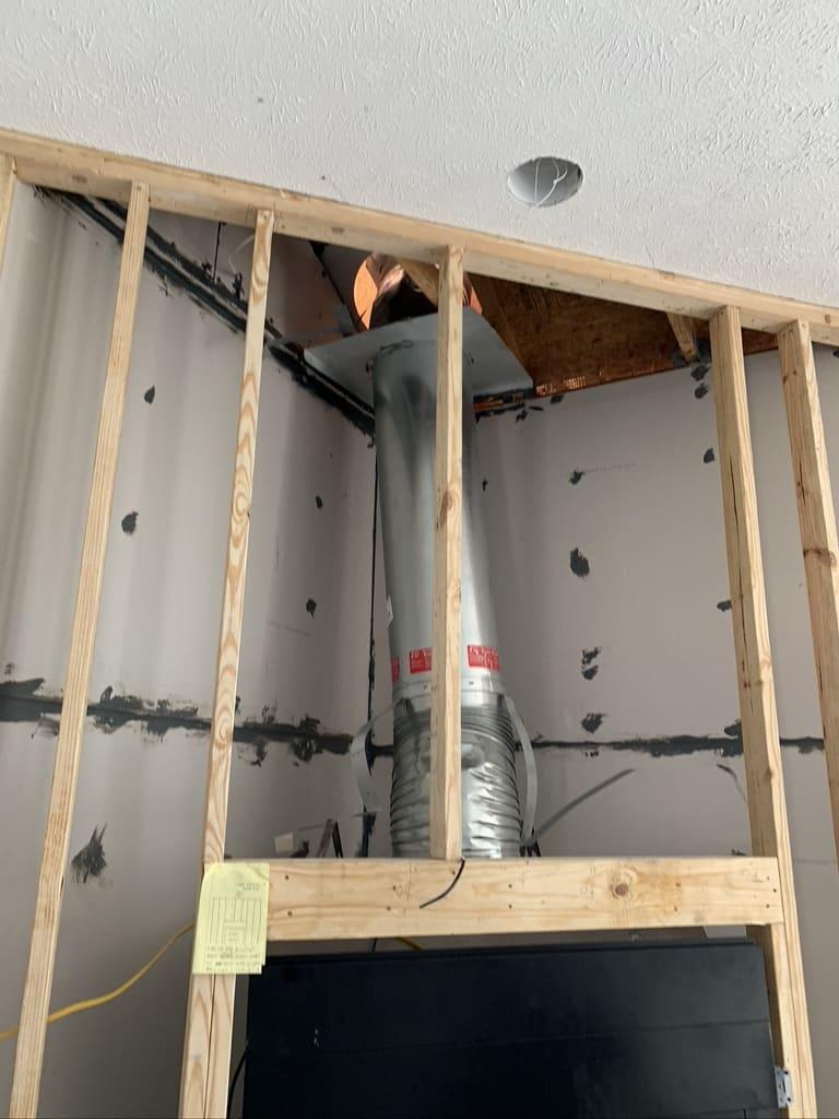 Exposed flue pipe for repair in Navarre