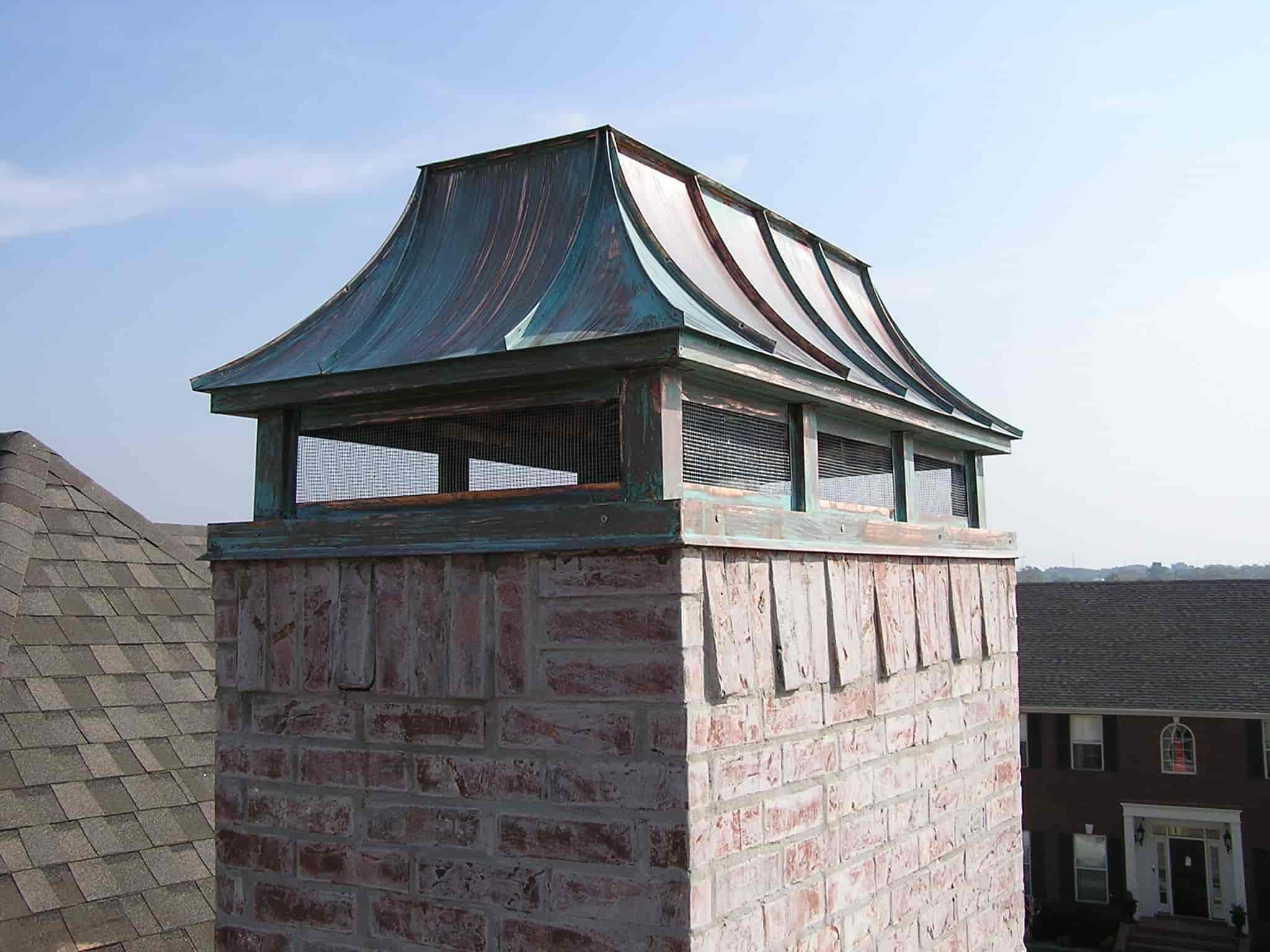 patina chimney cap installation on masonry chimney
