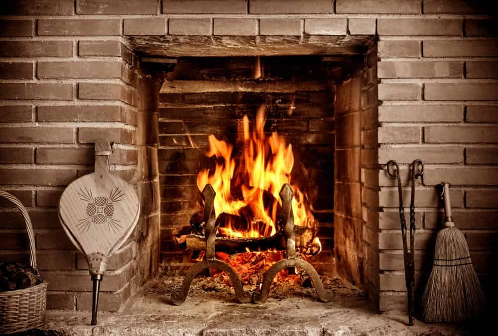 fire in fireplace in front of fireplace tools