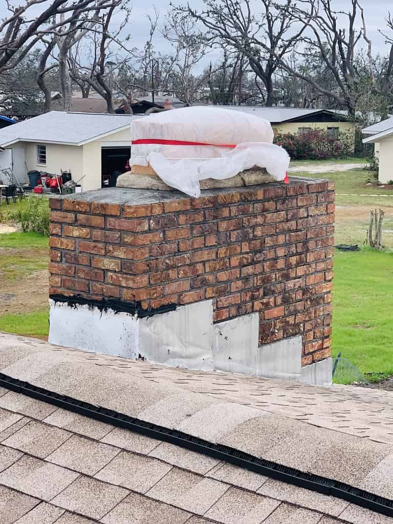 Brick Chimney Damage and repair after hurricane sally in Crestview, Call Sootmaster
