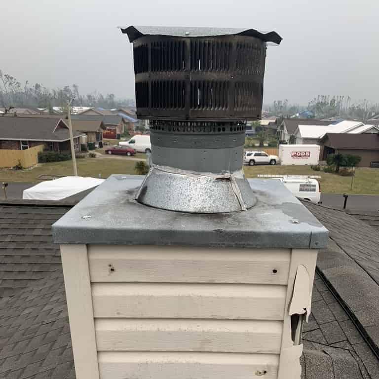 West Lake Sootmaster team repairing storm damaged chimney