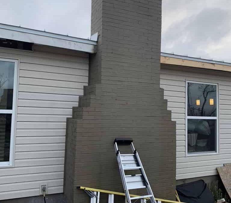 corbeled masonry chimney on outside of Prattville home