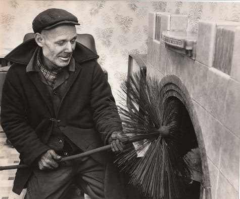 Black and White old photo of a chimney sweep