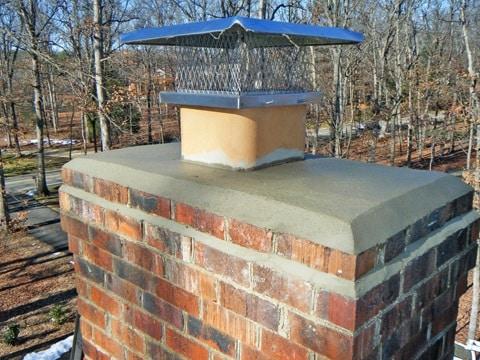 Chimney cap repair by Chimney Sweep Meraux