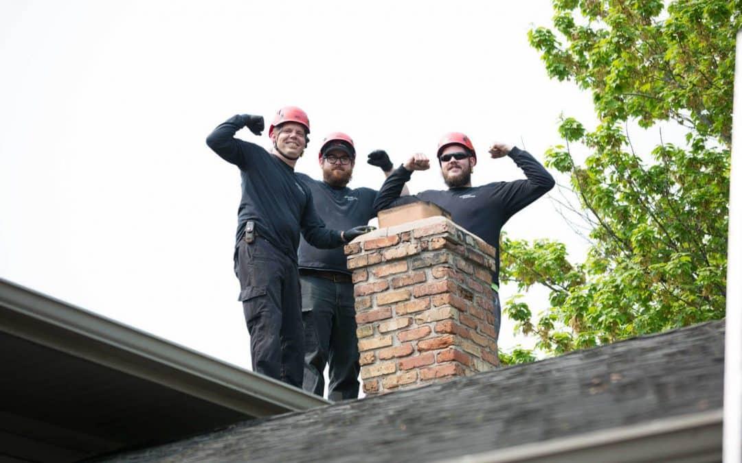 Three men sweeping a chimney